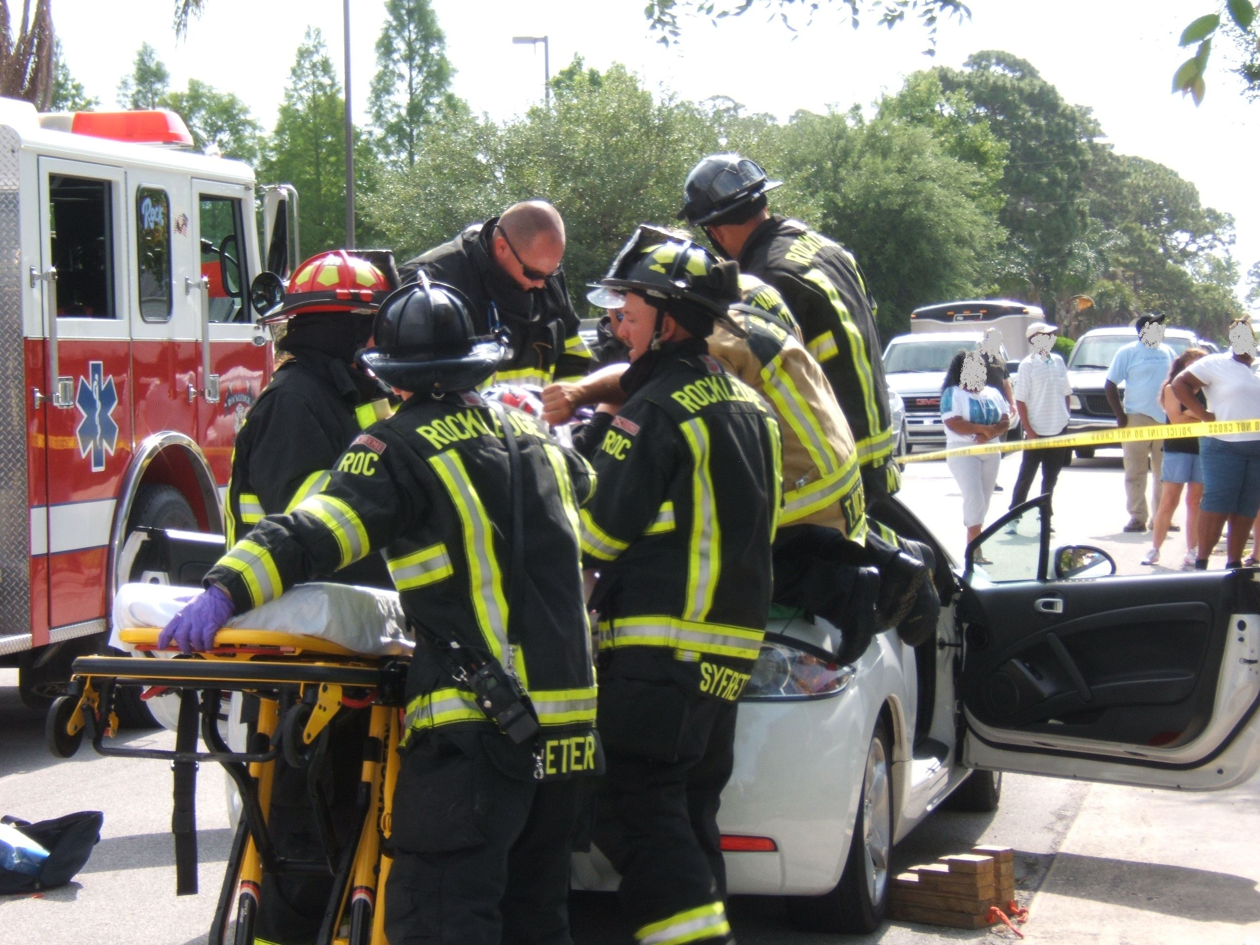Firefighters carrying a stretcher