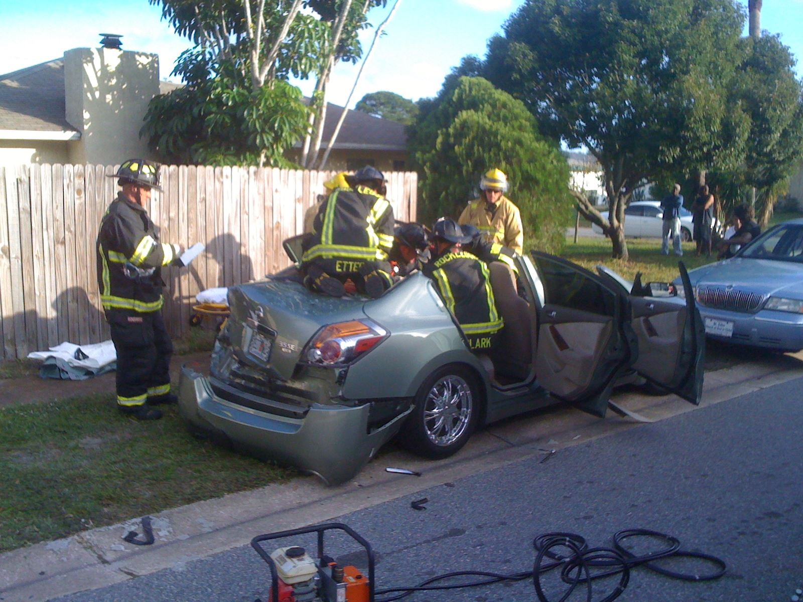 Firefighters in a damaged car